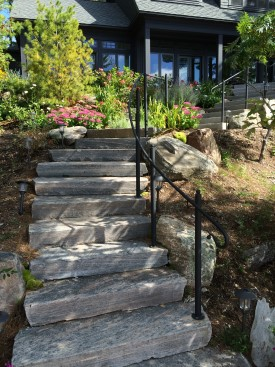 Stairs with retainment boulders and gardens